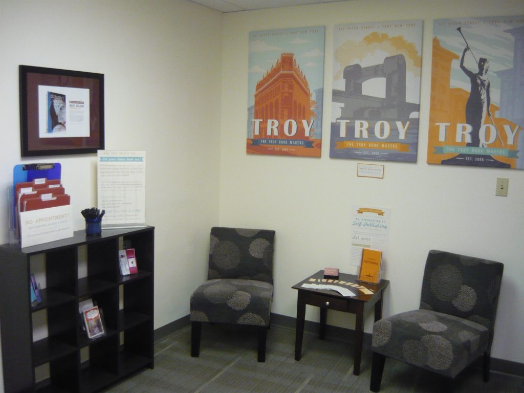 Our little lobby space, with Troy themed art by our staff.